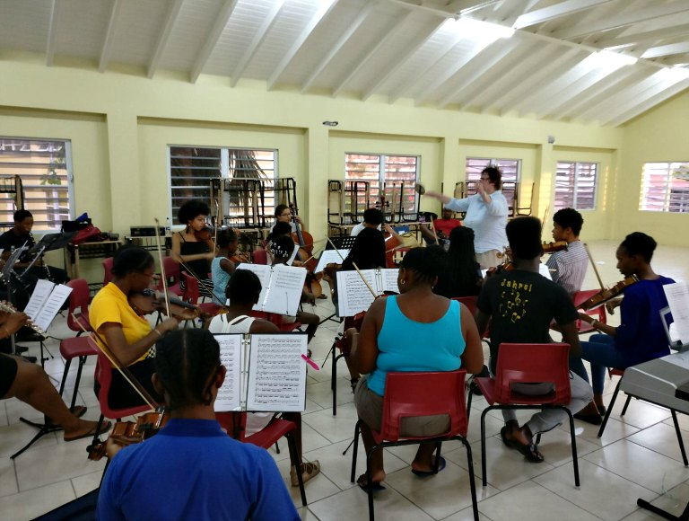 Antigua youth symphony orchestra in rehearsal with Ruth Whitehead
